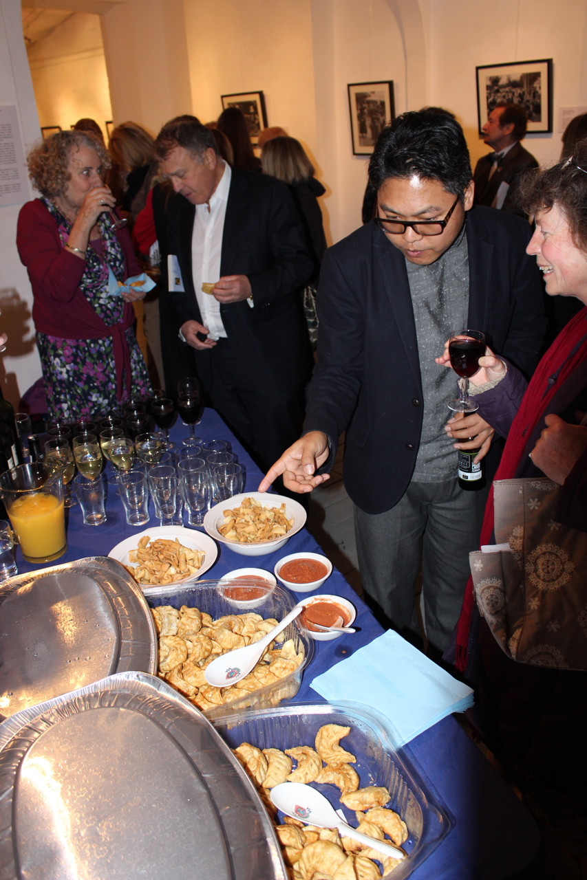 The opening reception - guests enjoy tradtitional Tibetan momos